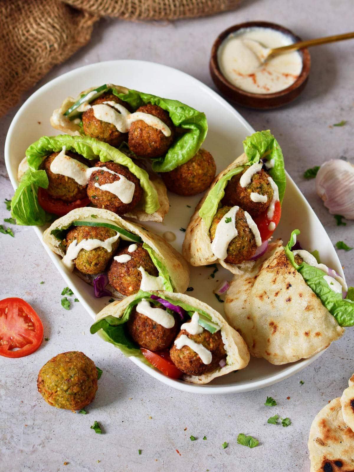 gluten-free air fryer falafel in pita pockets with veggies