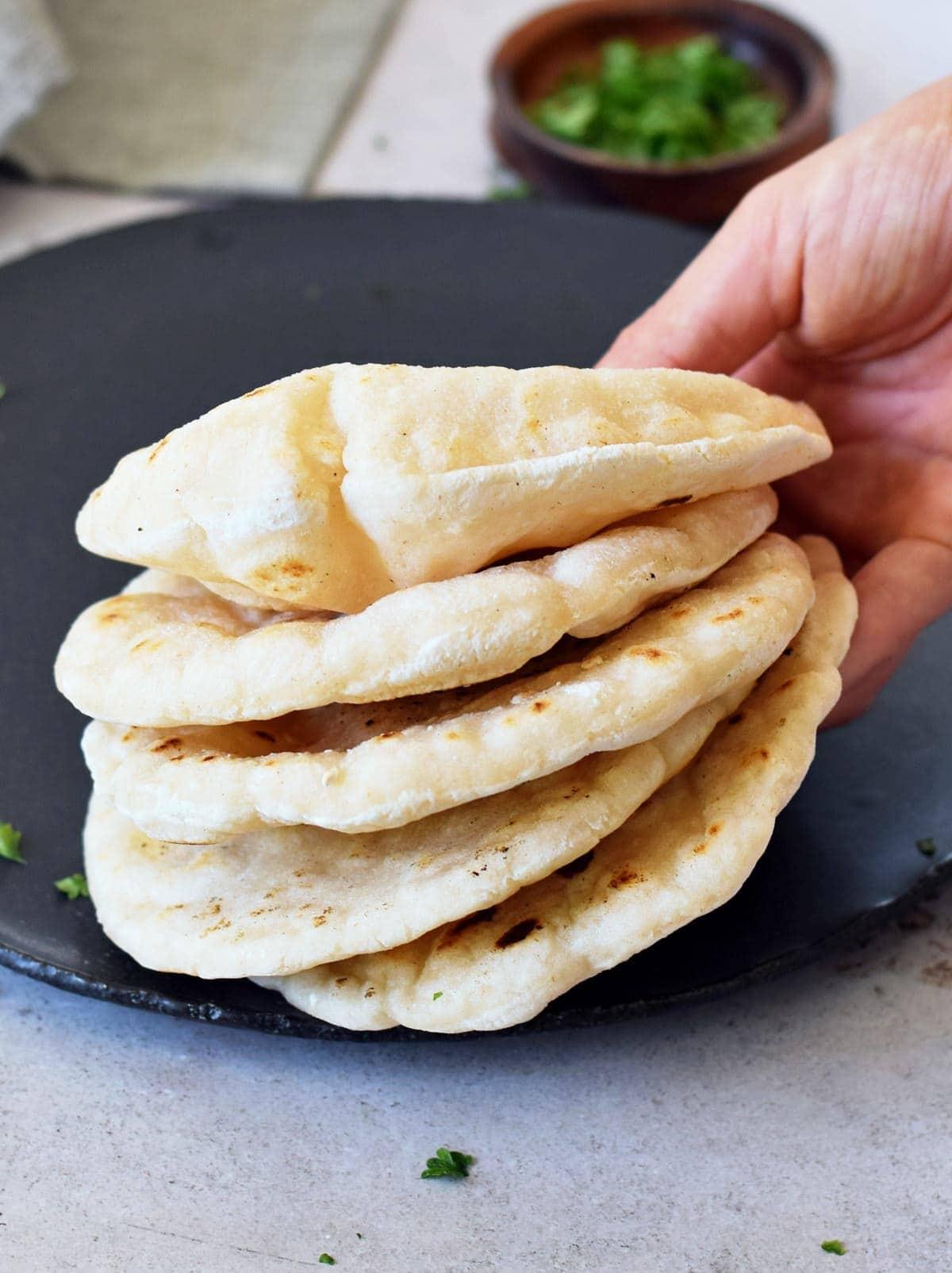 hand holding 5 gluten free flatbreads