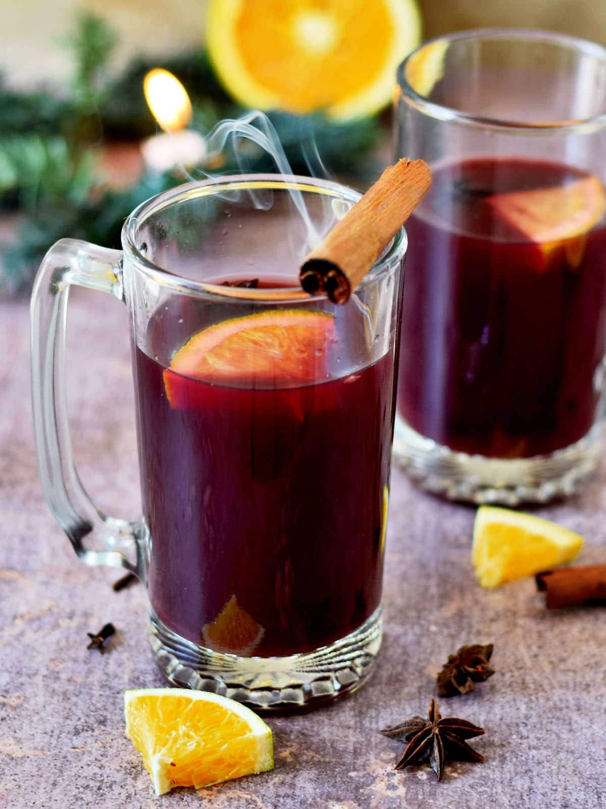 homemade mulled wine with cinnamon and orange in two jars