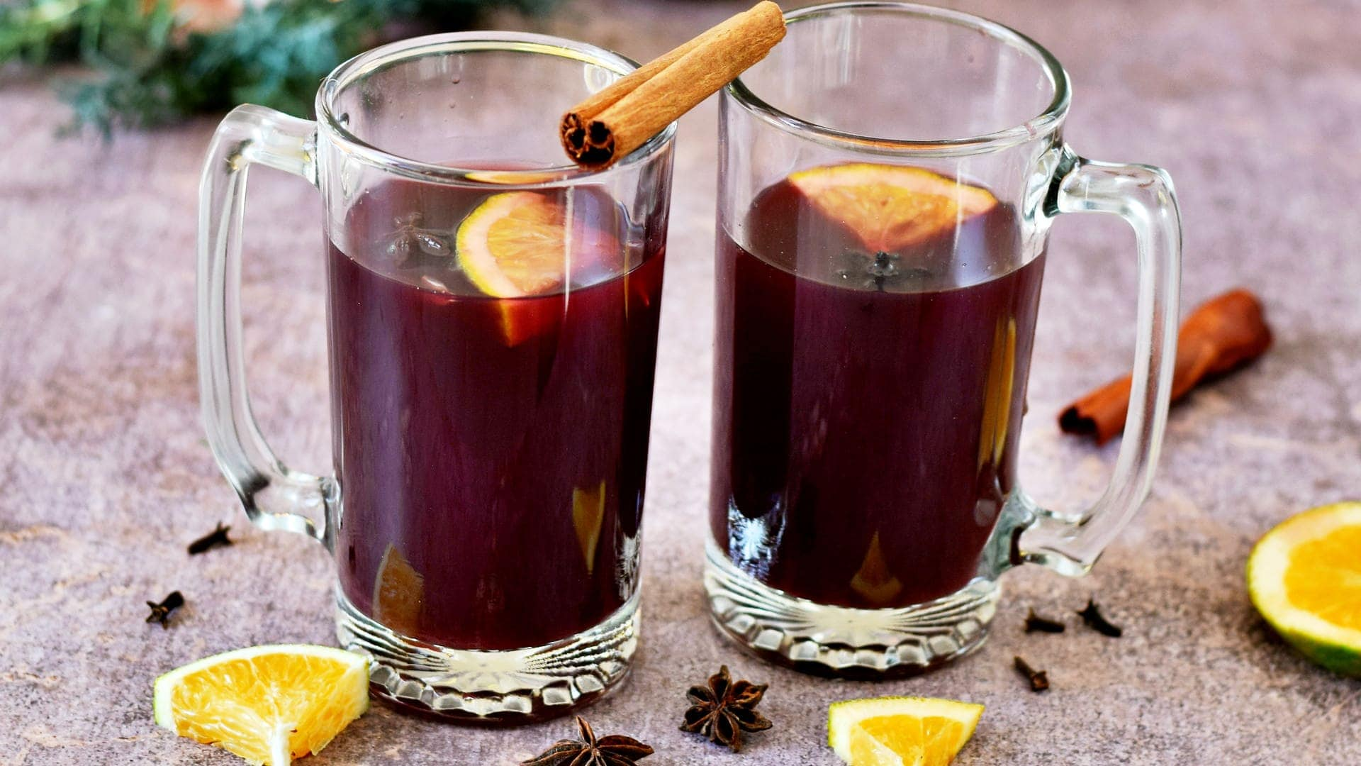 horizontal shot of mulled wine in two jars