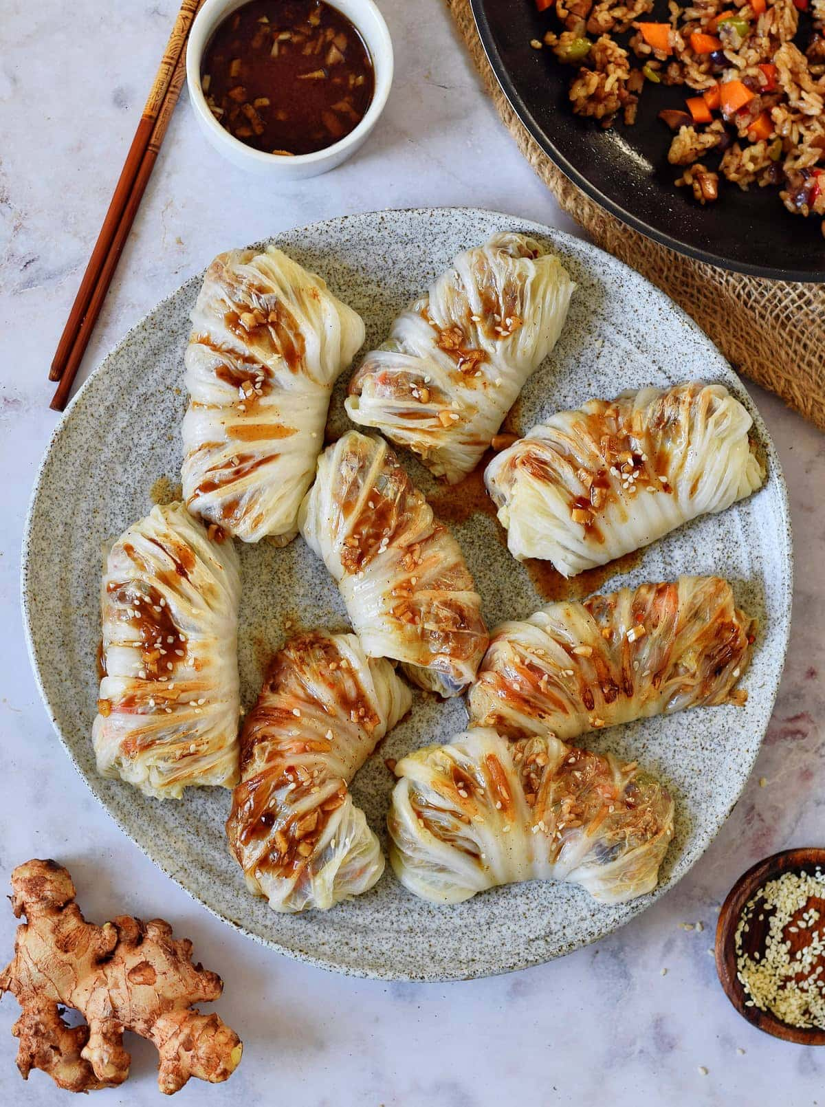 stuffed cabbage rolls on large gray plate