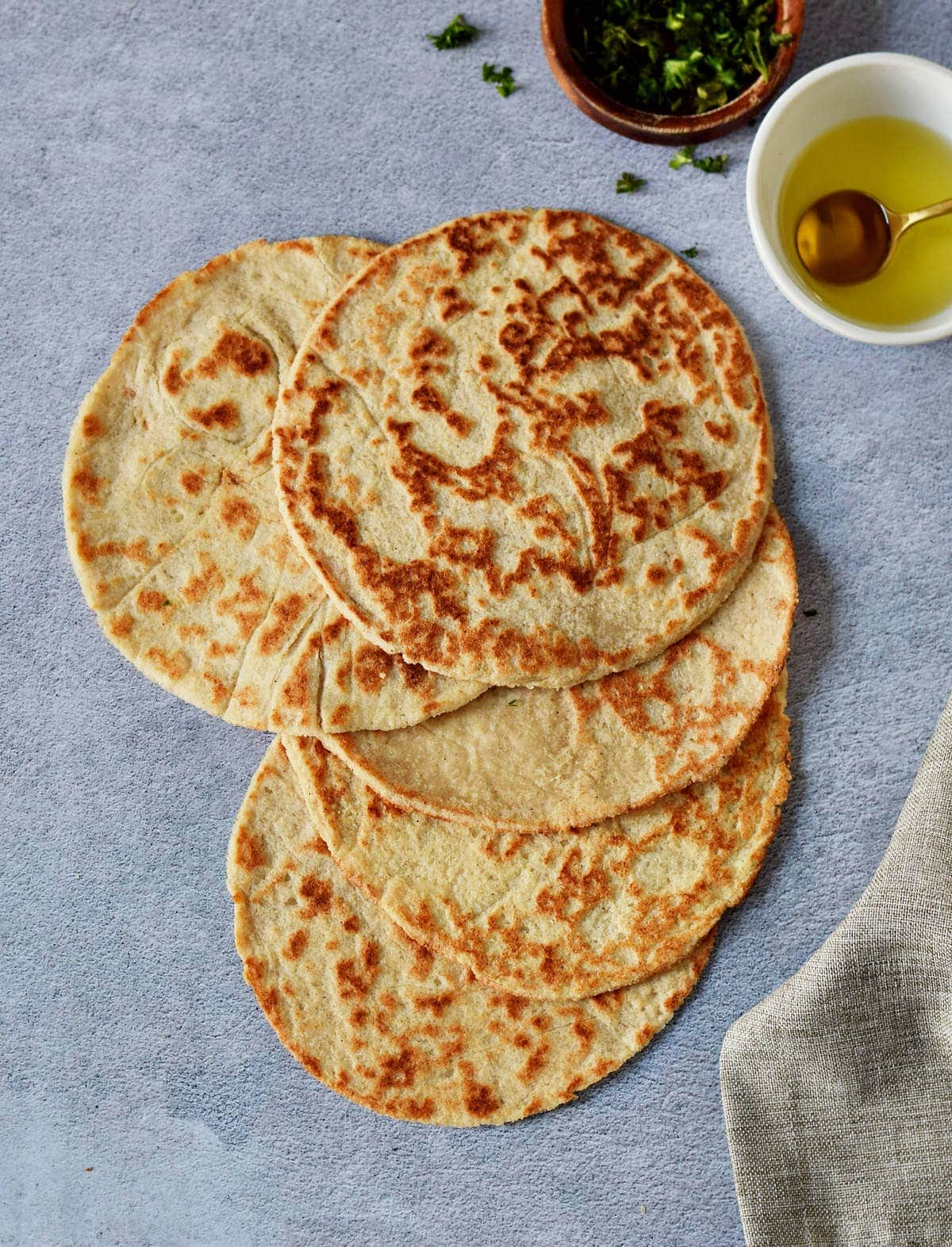5 low-carb keto tortillas on blue-gray backdrop