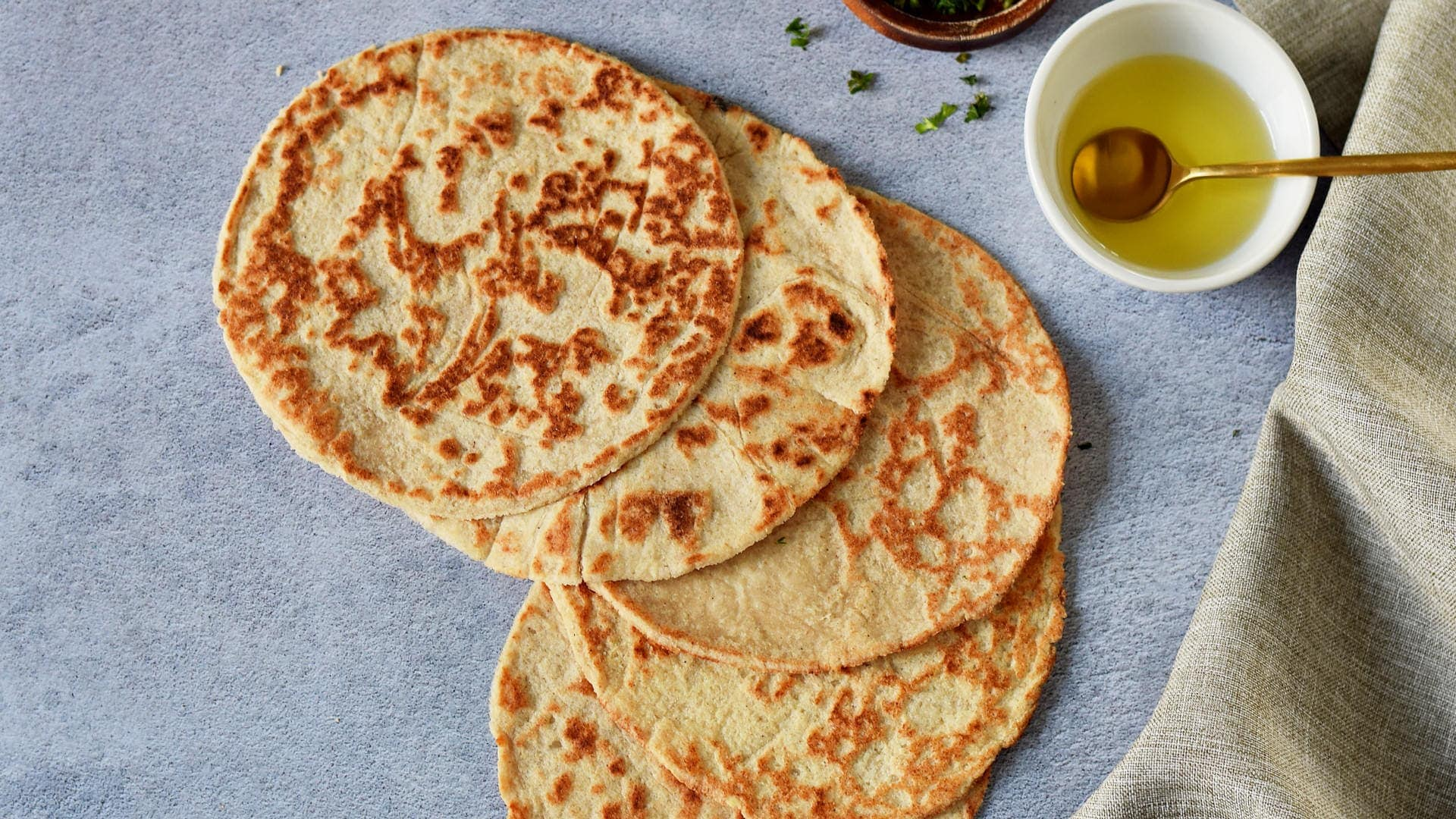 horizontal shot of low carb tortillas with oil in bowl