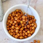 crispy air fryer chickpeas with spoon in white bowl