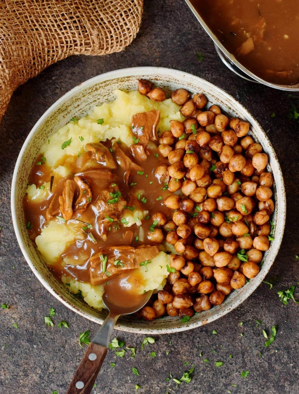 gravy with mashed potatoes and chickpeas in bowl
