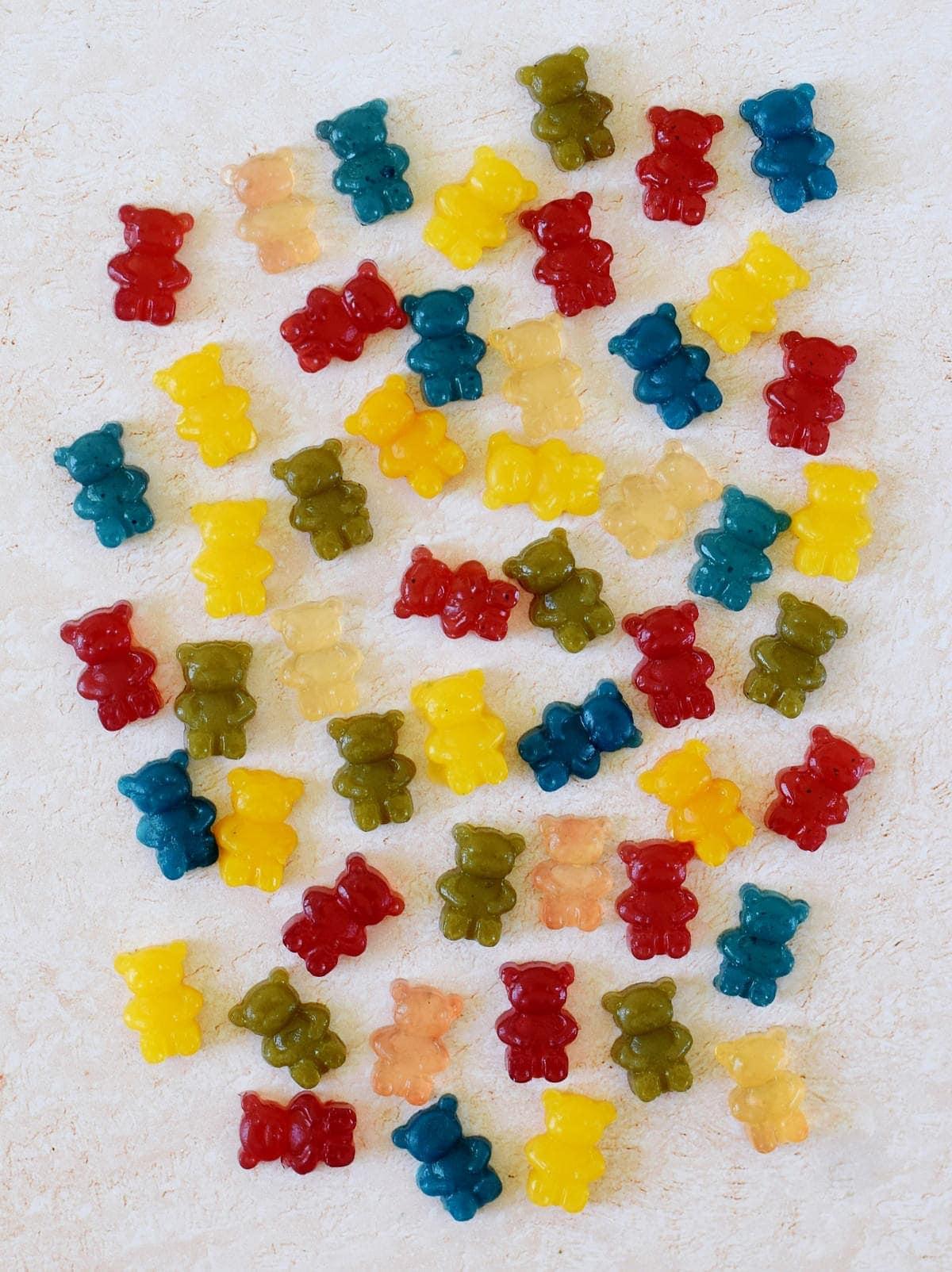 homemade vegan gummy bears in 6 colors on light background