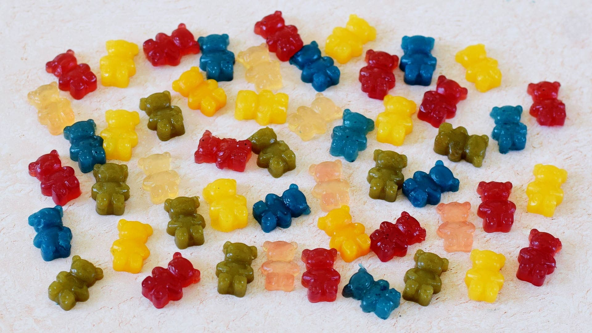 horizontal shot of gelatin-free gummy bears on light background