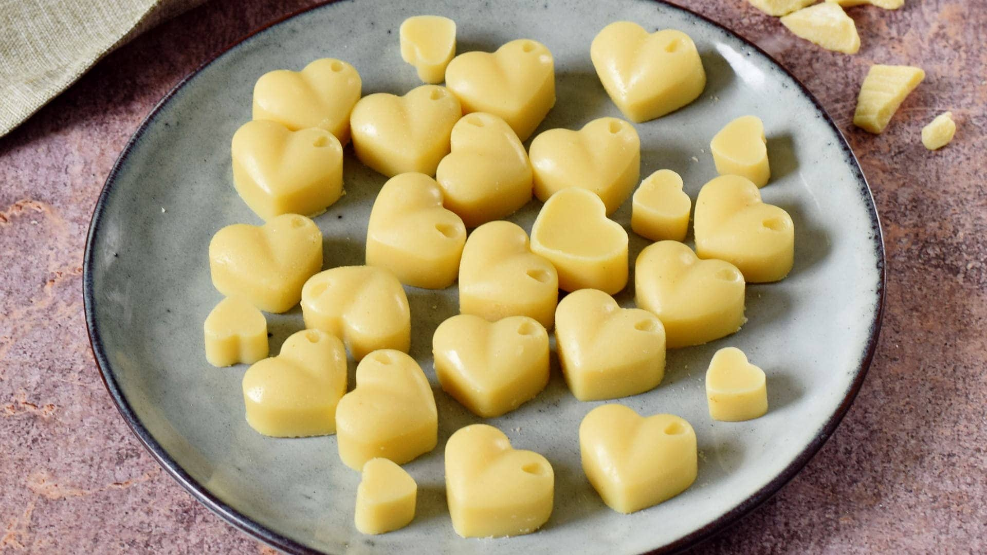 horizontal view of white chocolate hearts on a plate