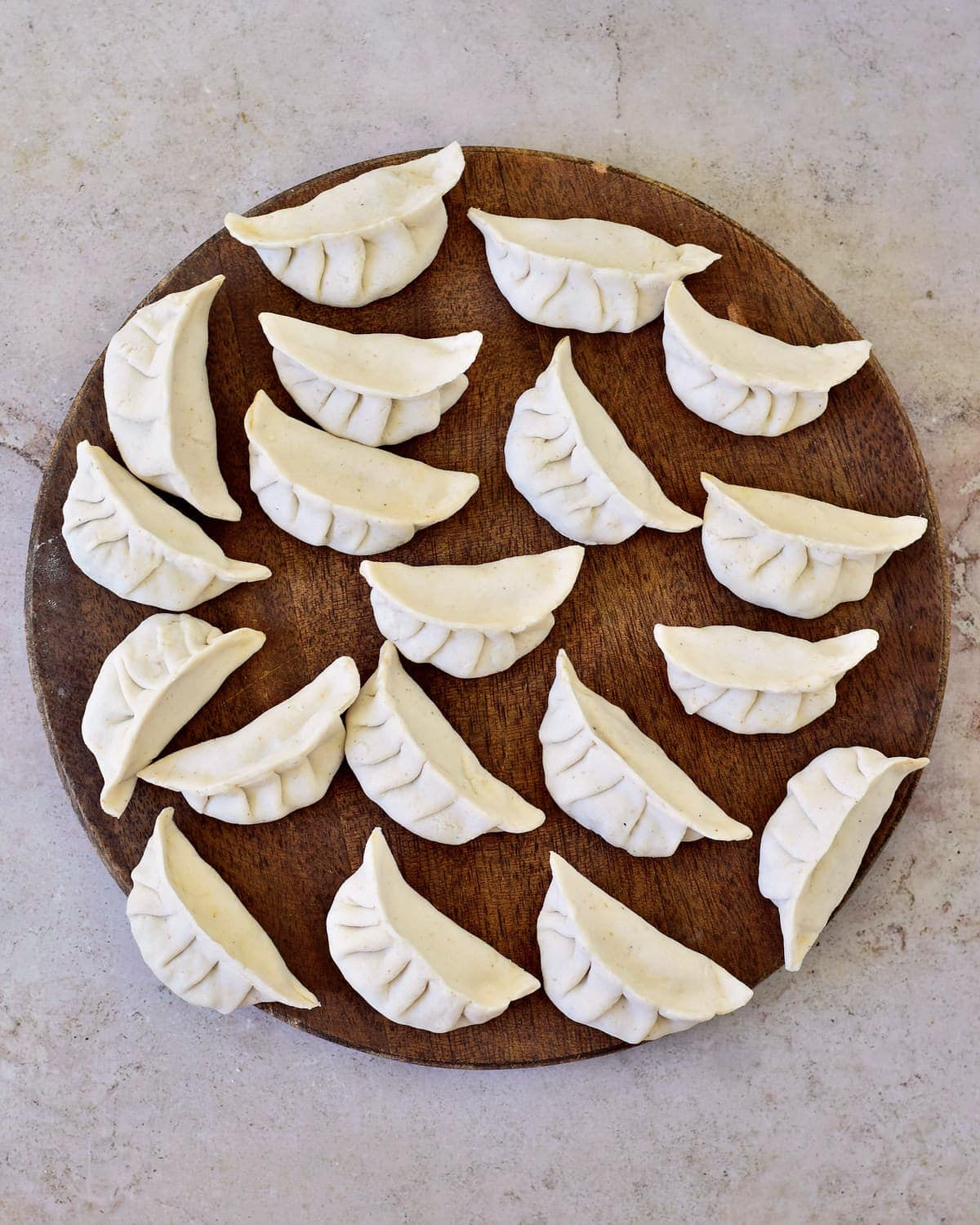 pleated Gyoza or Potstickers on wooden board
