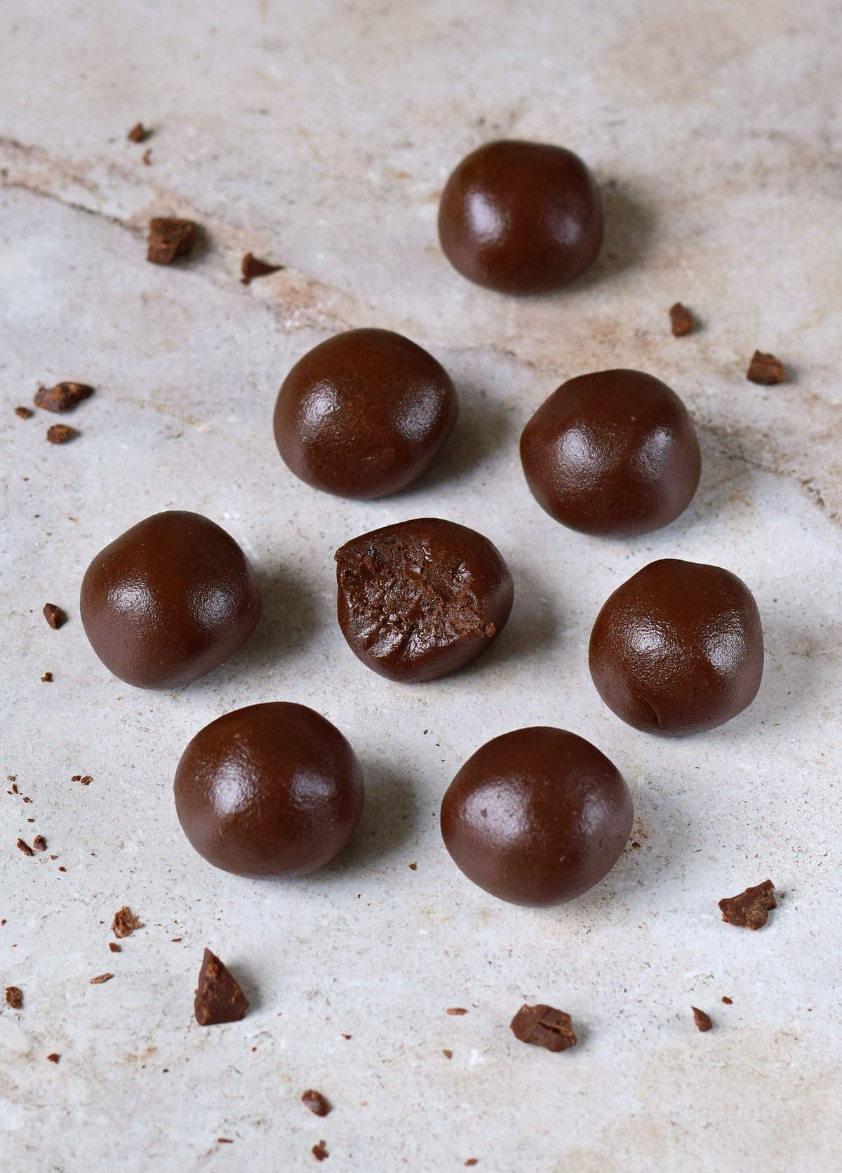 8 chocolate balls on light background