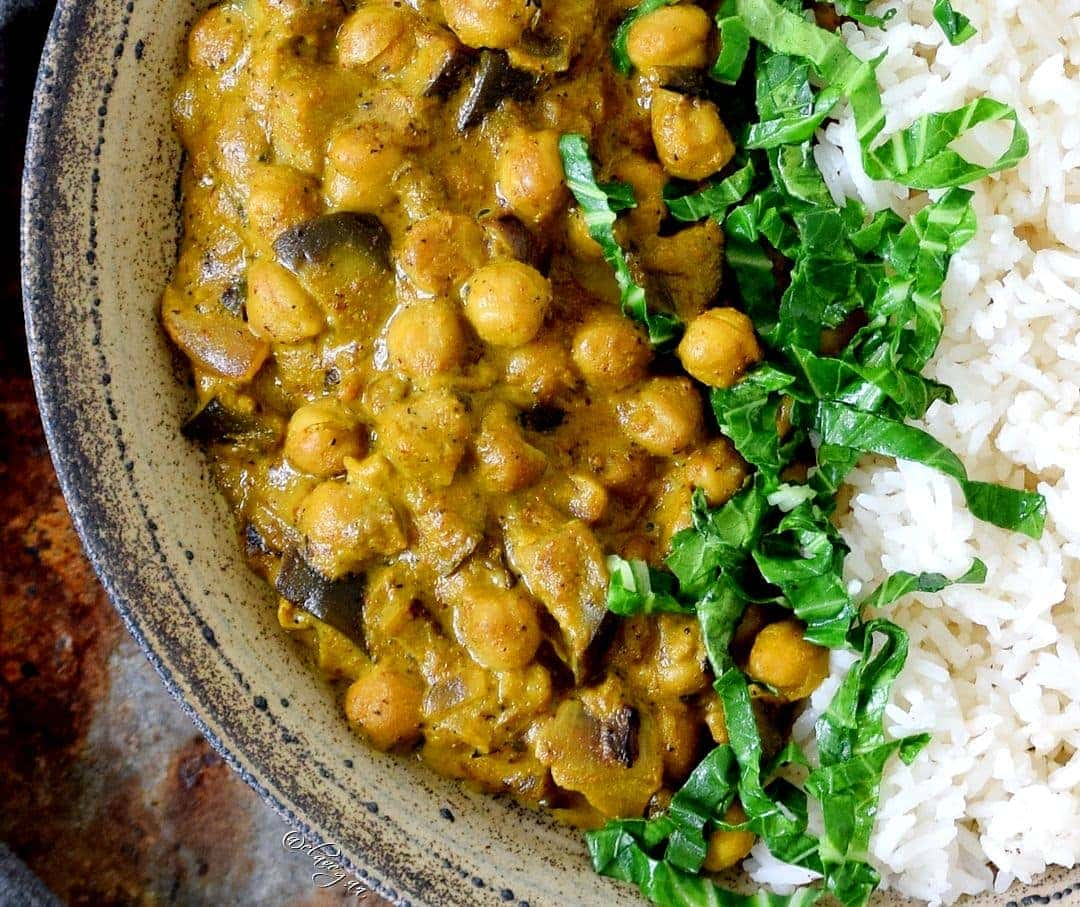 Close-up of vegan Indian dish with rice, chickpeas, and spinach