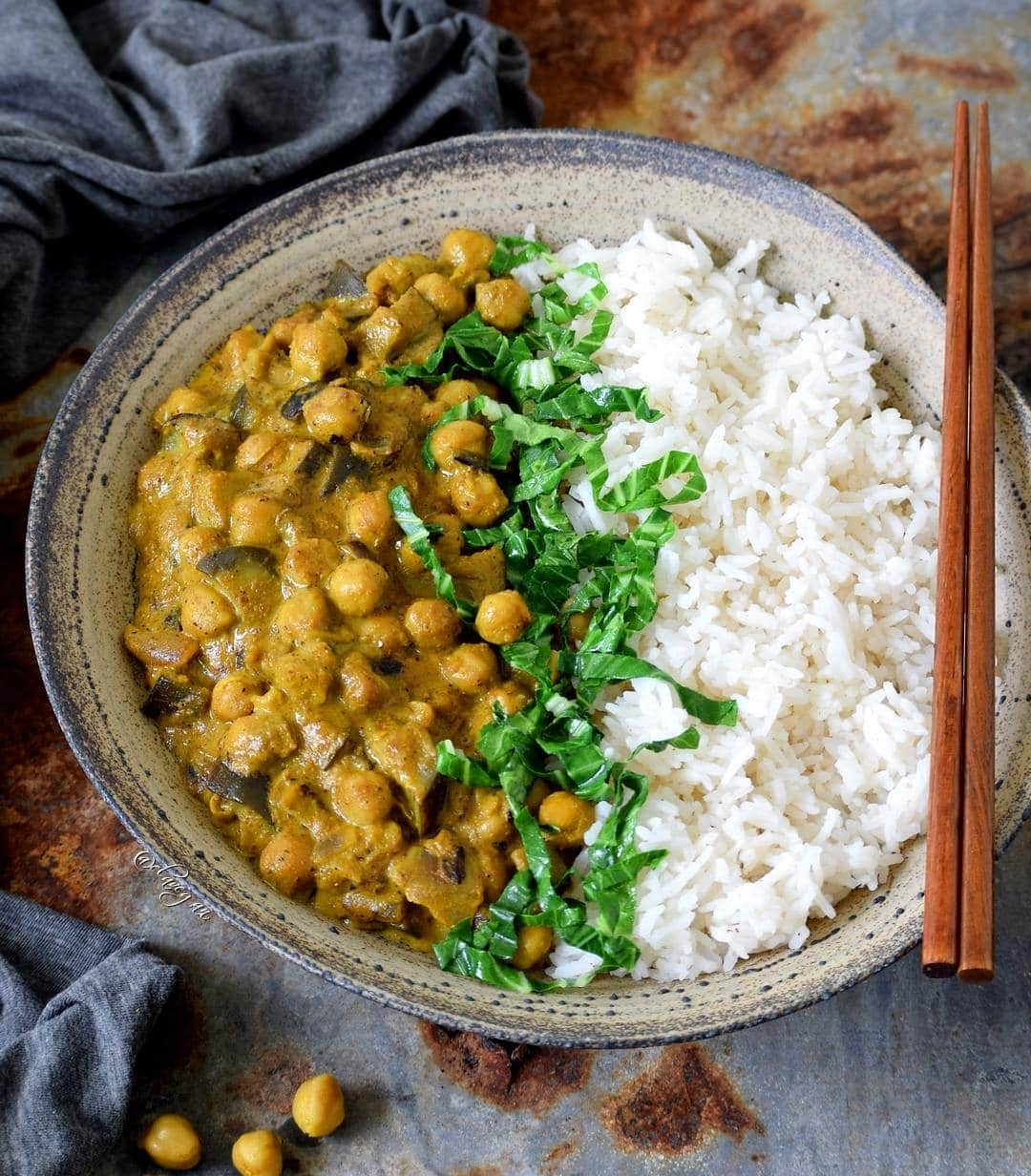 Vegan chickpea aubergine dal in bowl with rice