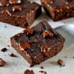 close-up of vegan black bean brownies with melted chocoalte on top