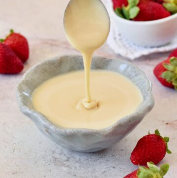 homemade vegan condensed milk in bowl with spoon