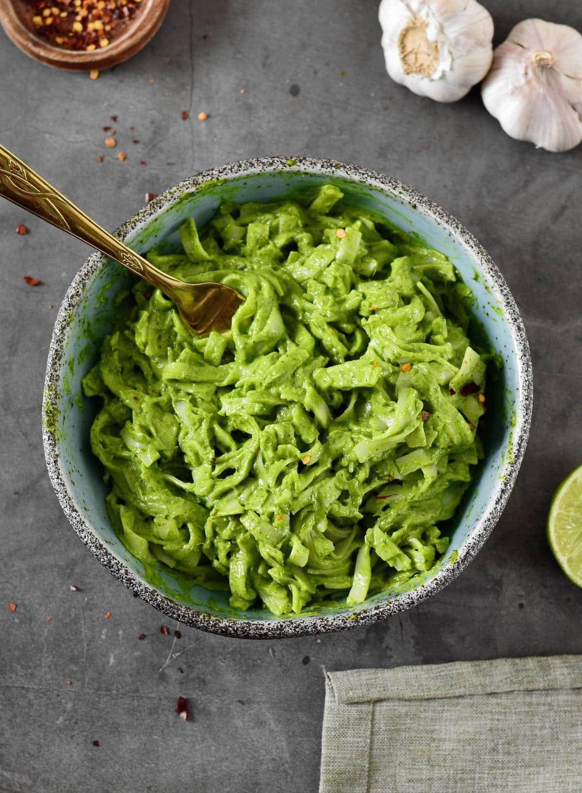 top shot of green creamy noodles in bowl