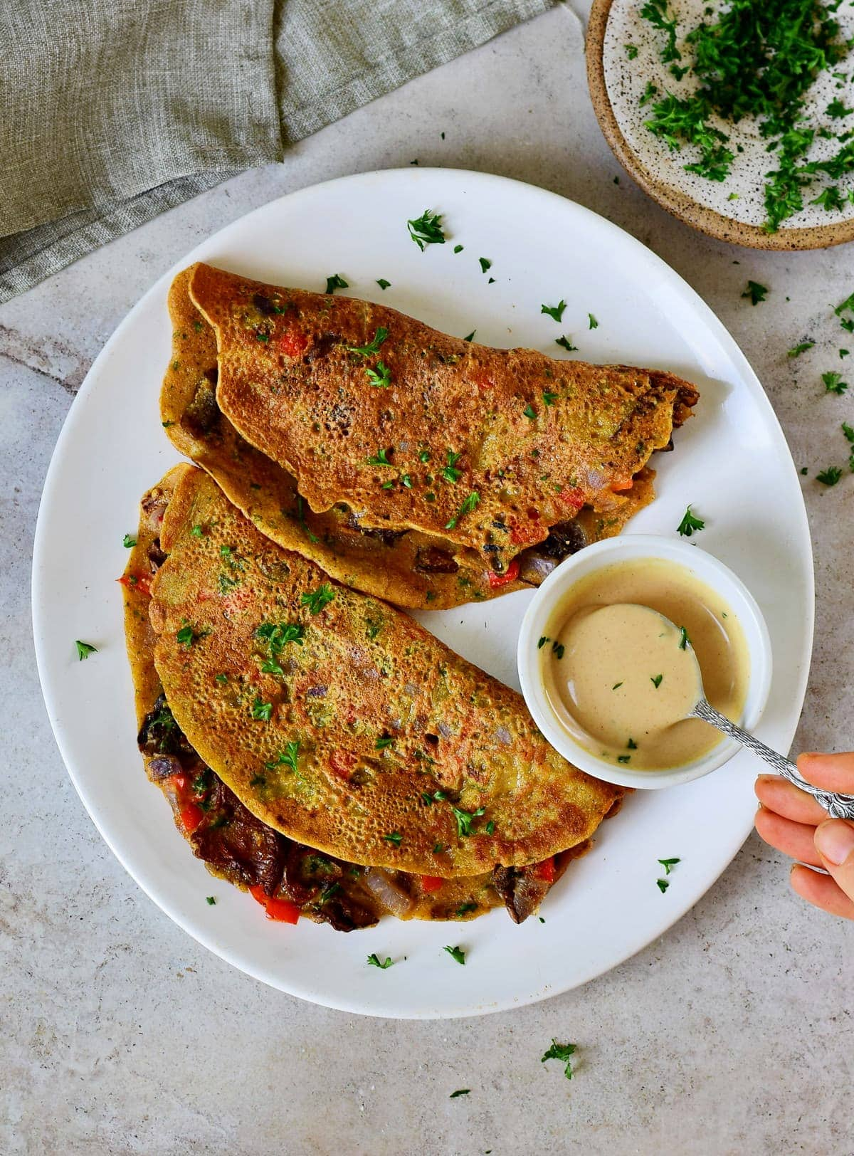 2 vegan omelettes from above on white plate with dip