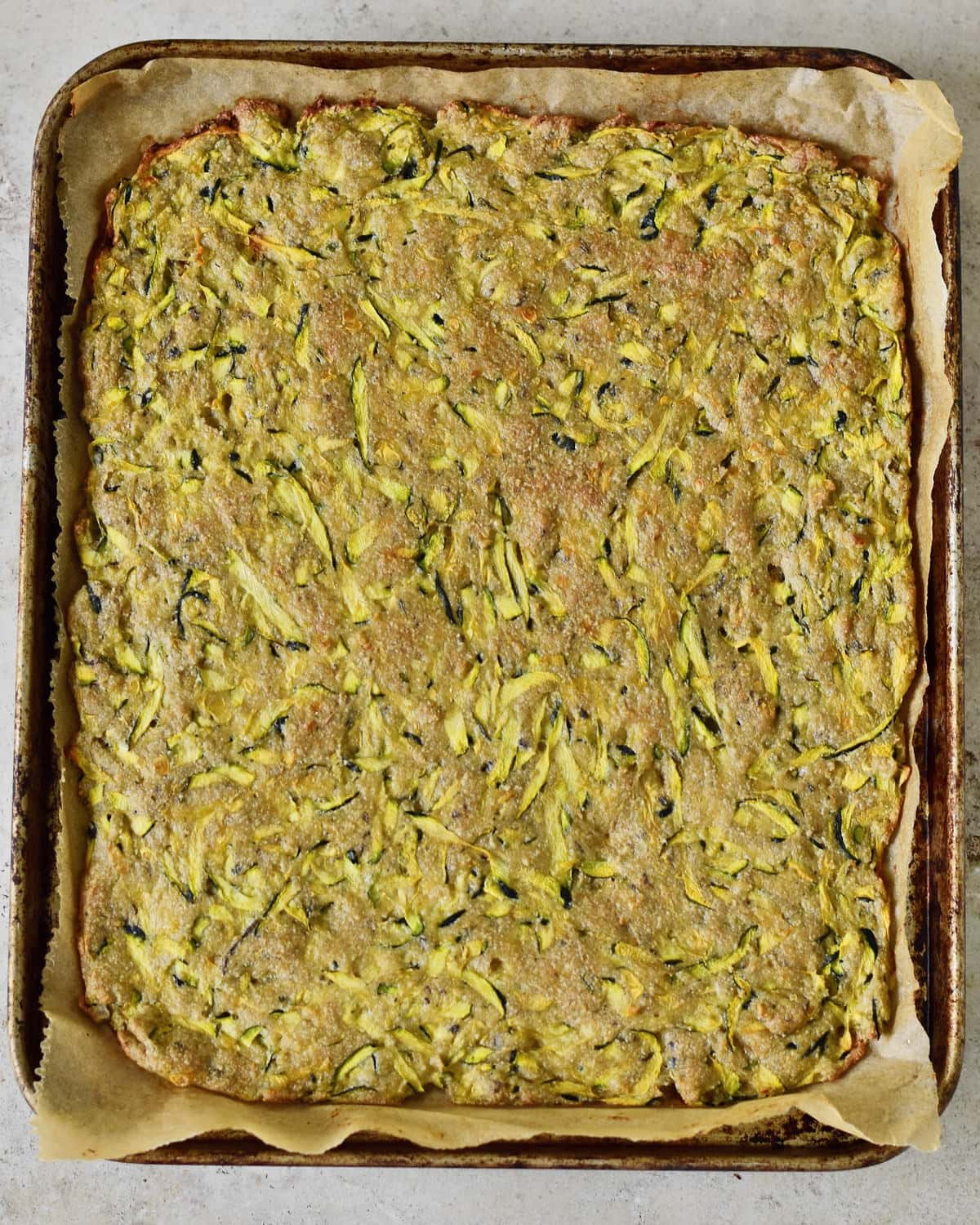 baked rectangular zucchini pizza crust without toppings