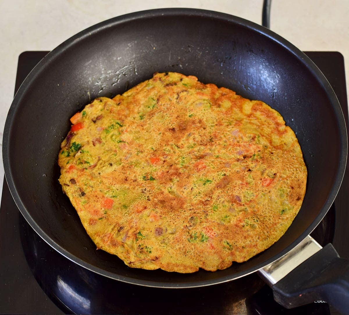 vegan omelette in black pan