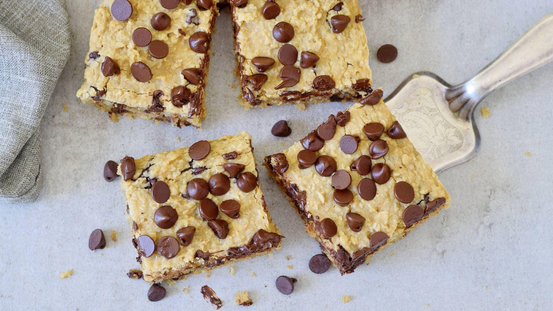 horizontal shot of 4 vegan oatmeal chocolate chip bars