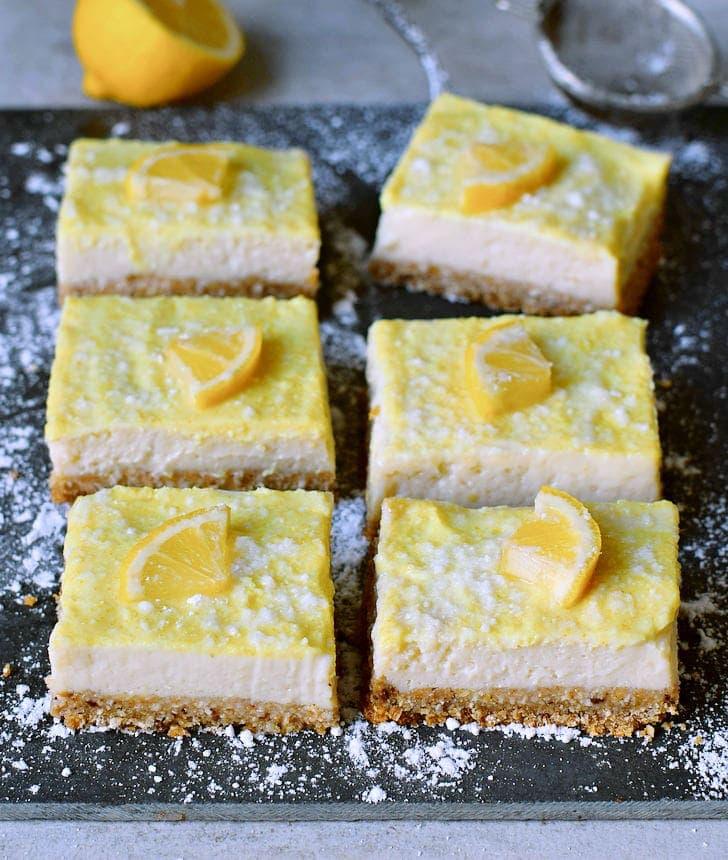 6 lemon cheesecake bars with lemon slices