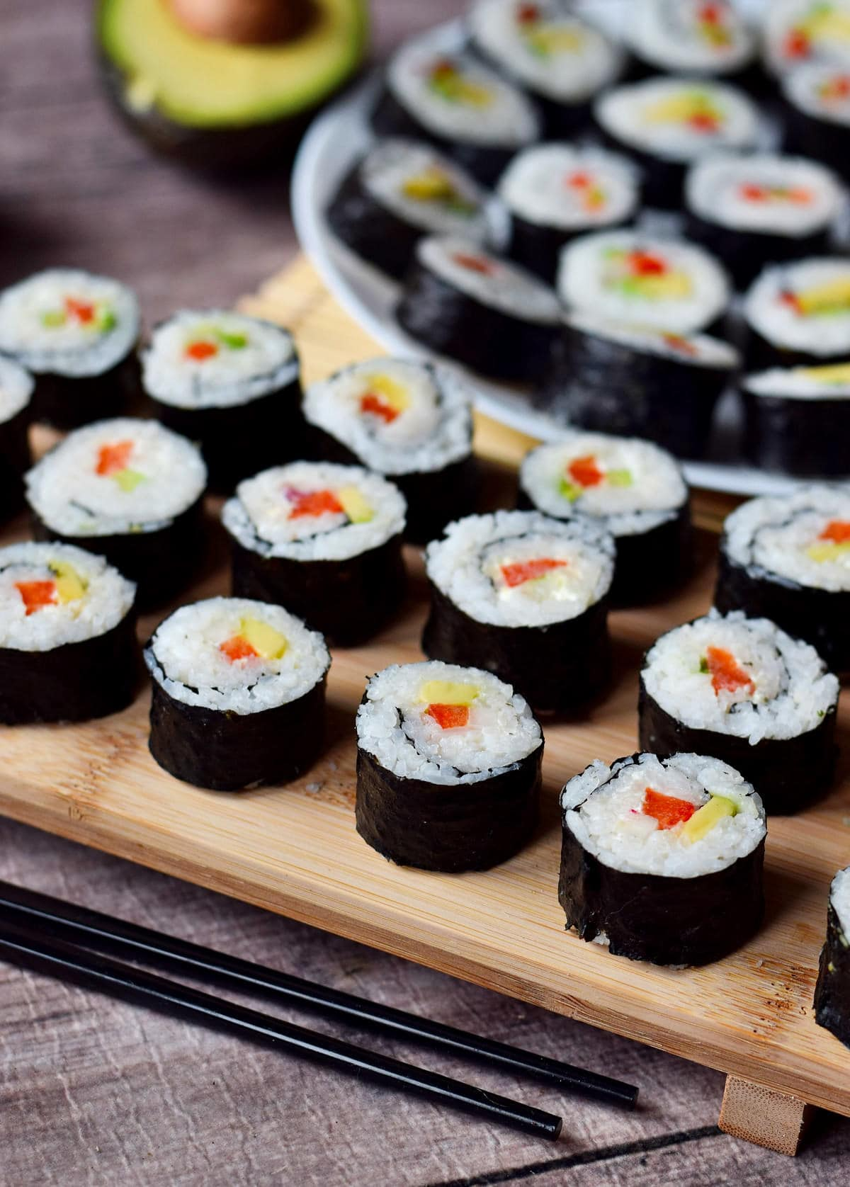 close-up of sushi rolls on wooden board