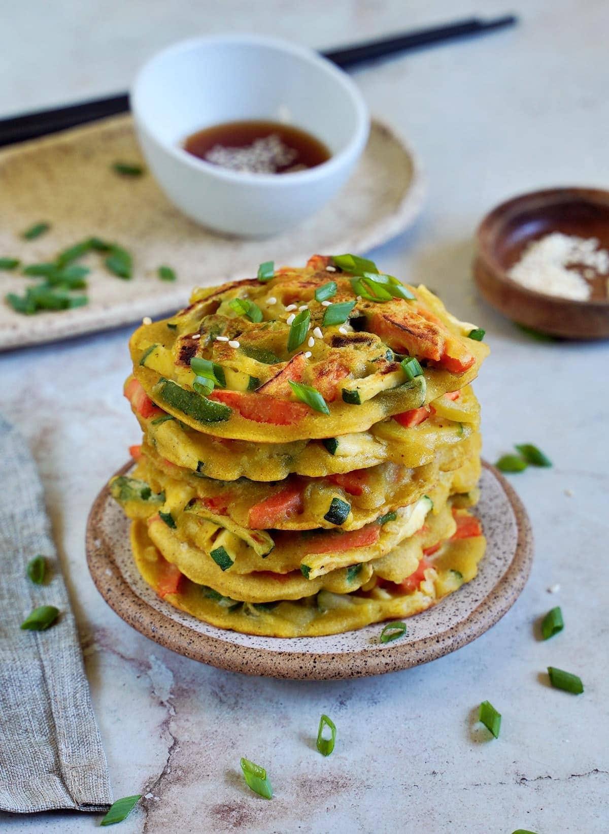 pajeon - Korean scallion pancake stack on small plate