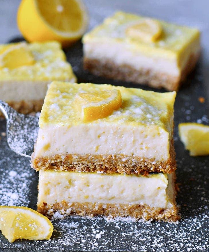 stack of 2 creamy lemon cheesecake bars from the side