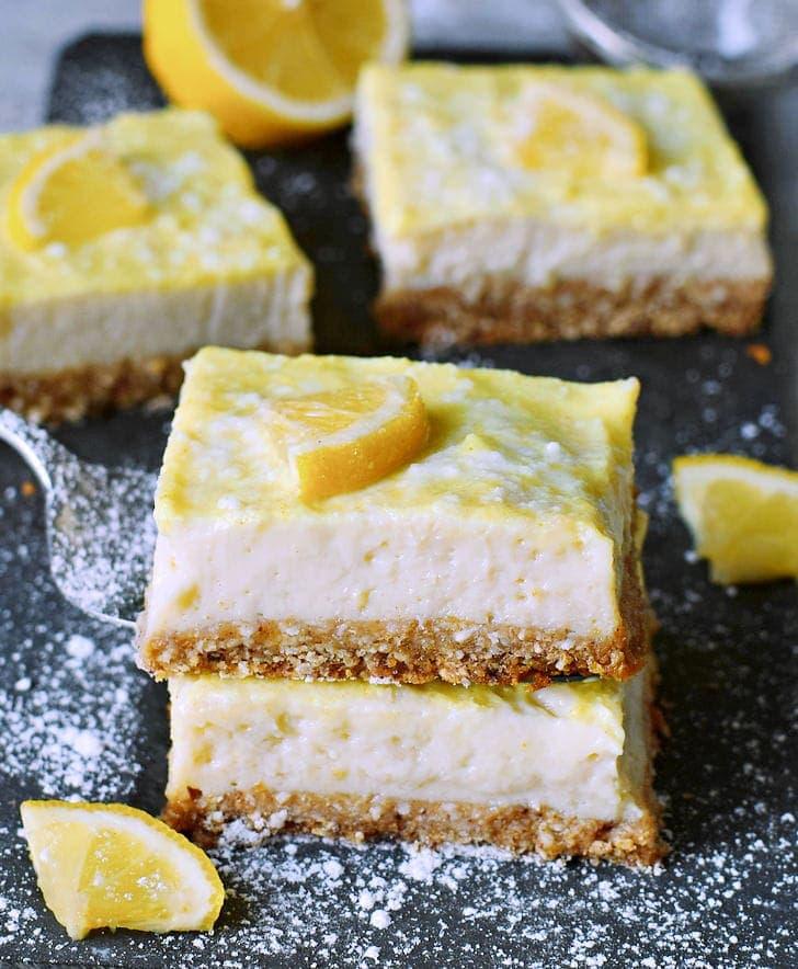 stack of 2 lemon cheesecake bars with lemon slices
