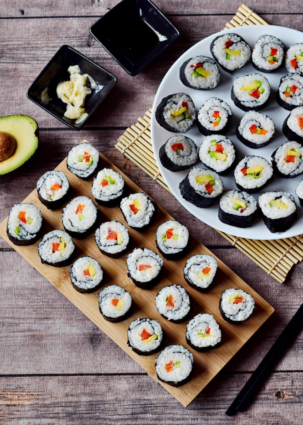 sushi without fish on wooden board and plate from above