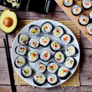 vegan sushi on a white plate from above