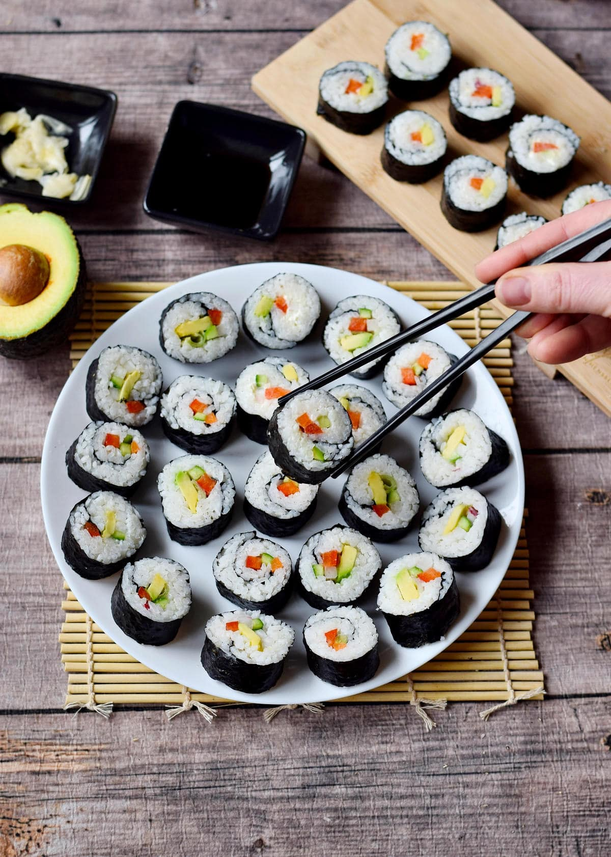 makizushi on a white plate with chopsticks