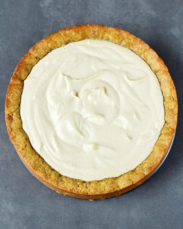 white cream filled onto cake crust