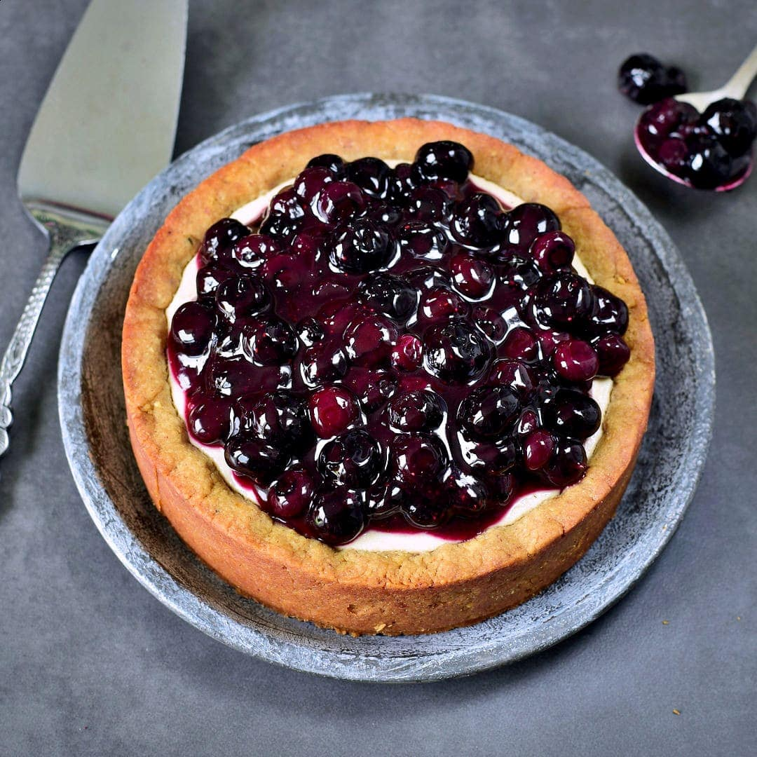 whole vegan pie with blueberries on top