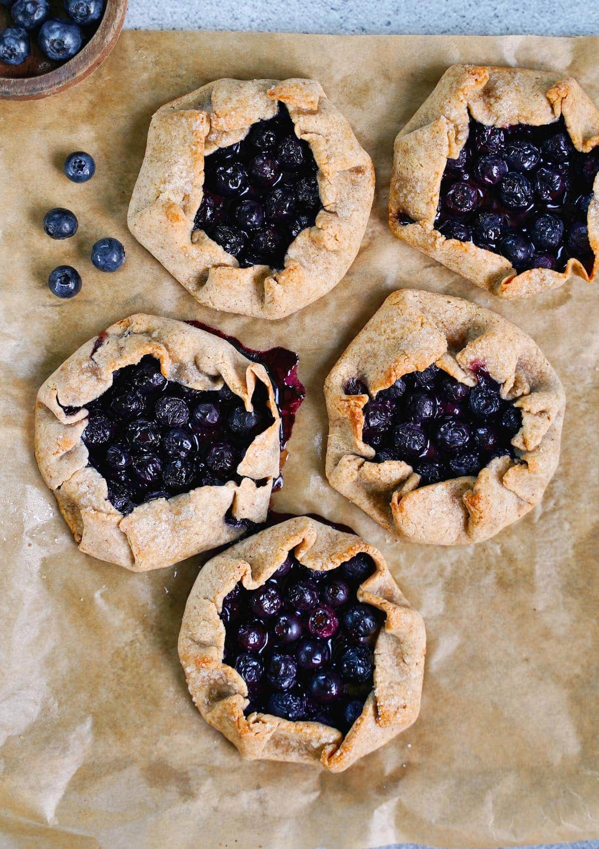 5 baked mini galettes with blueberries