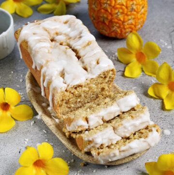 fresh pineapple bread with sugar-free icing and yellow flowers as decoration