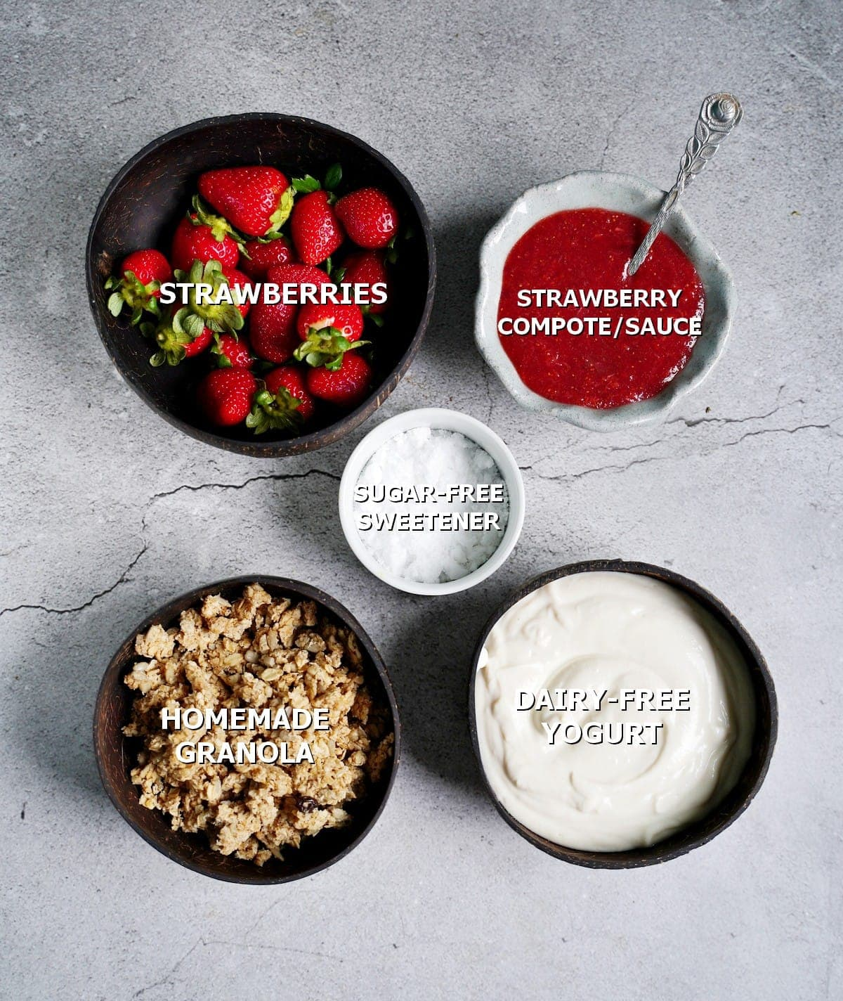 ingredients for a layered dessert in a jar with strawberries