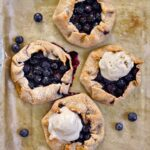 top view of 4 blueberry galettes 2 topped with dairy-free ice cream