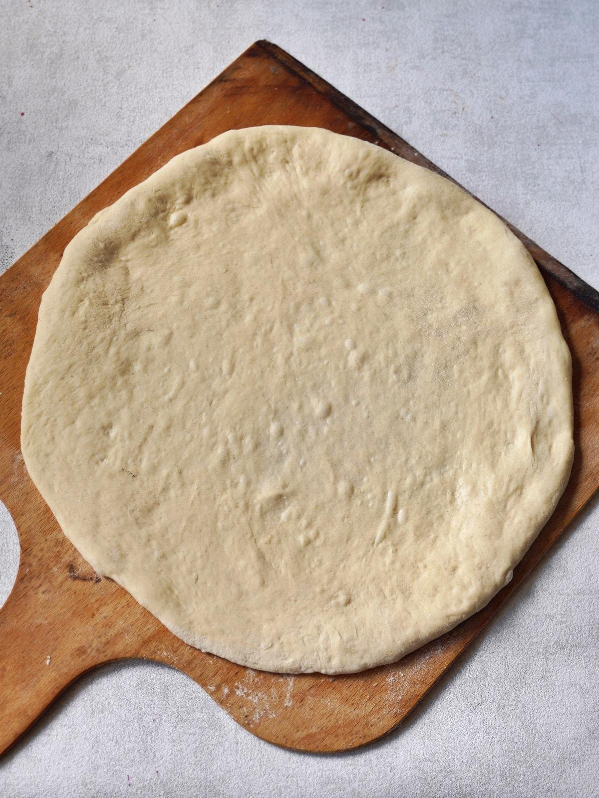 spelt flour pizza dough on wooden board