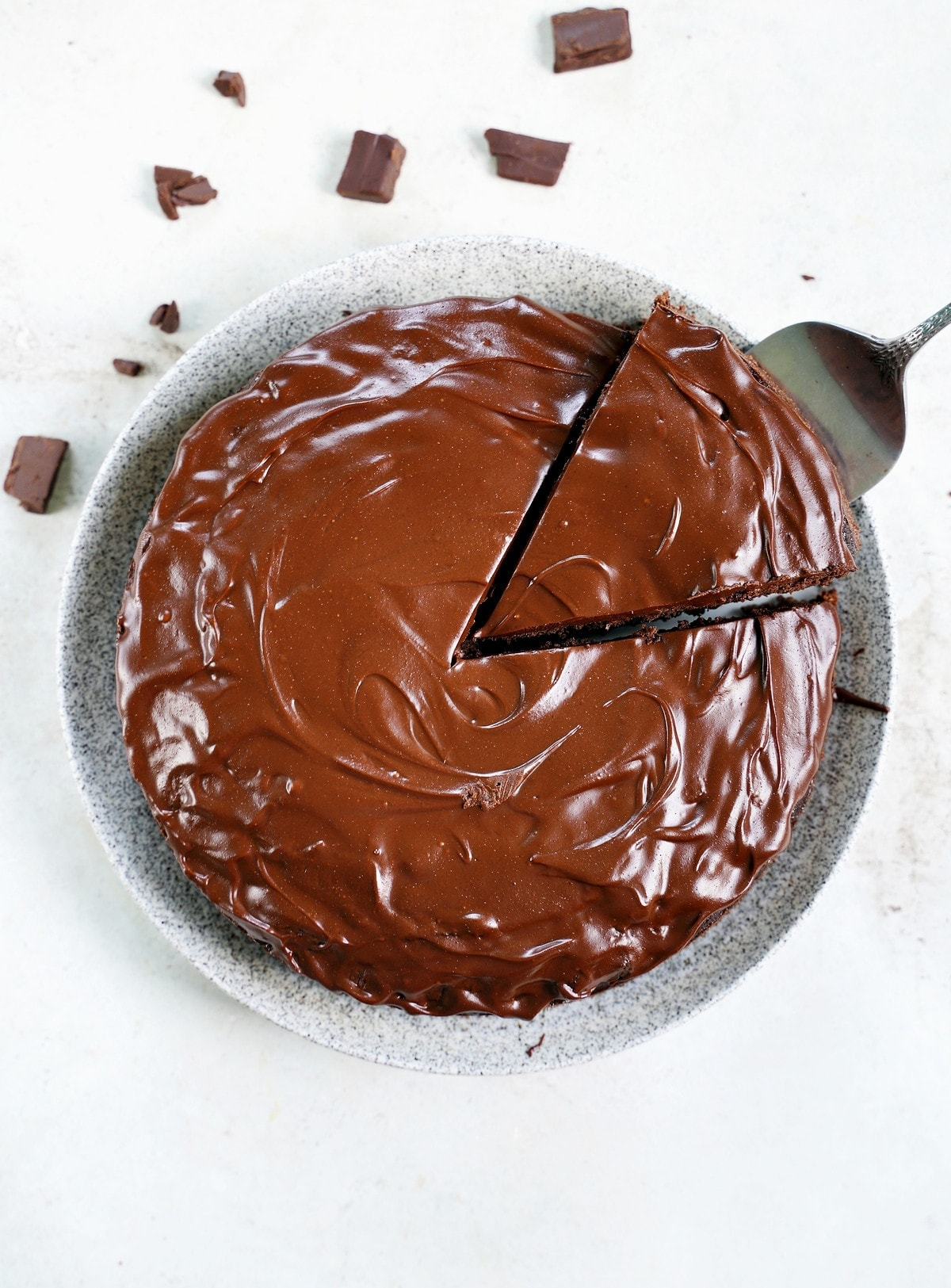 avocado chocolate cake with piece cut out from above