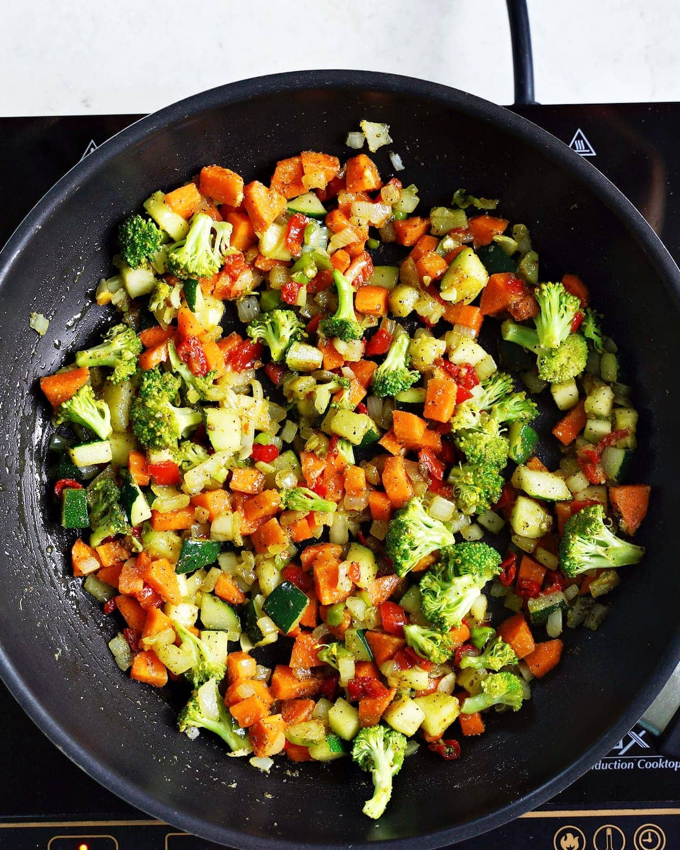 black skillet with veggies