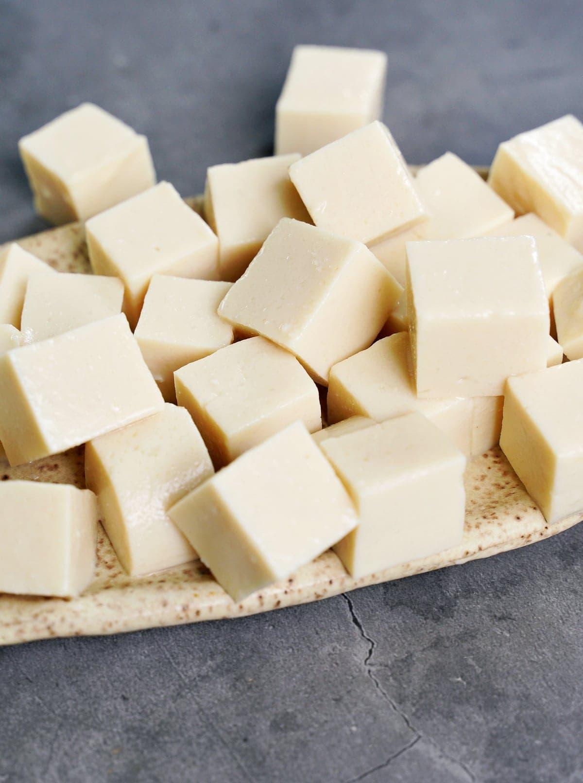 close-up of homemade white silken tofu cubes