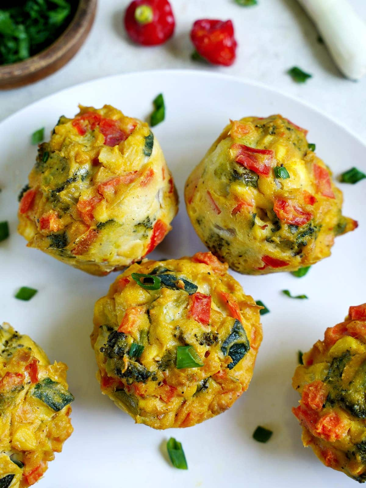 close-up of savory muffins on white plate