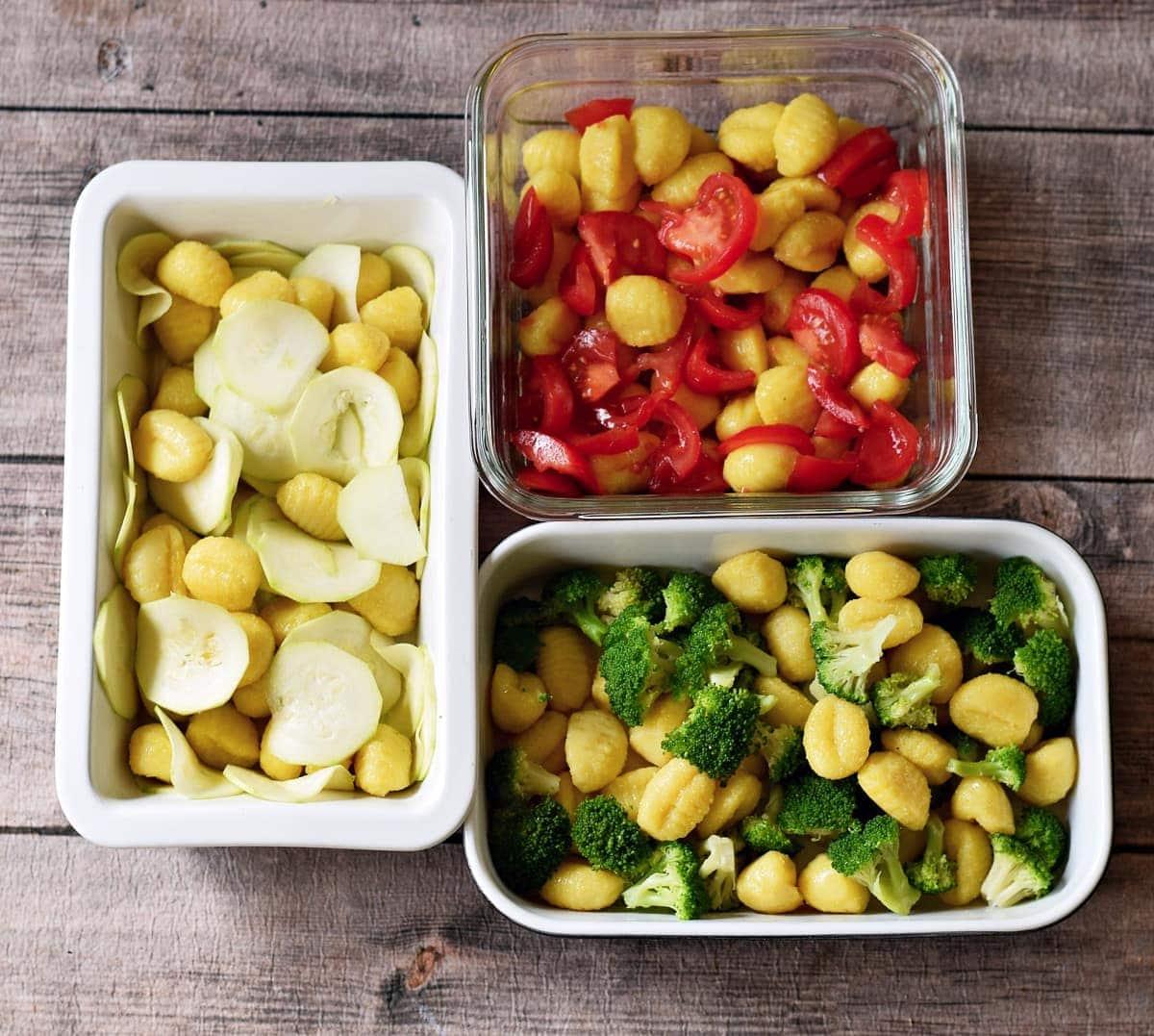 gnocchi and veggies in 3 baking pans