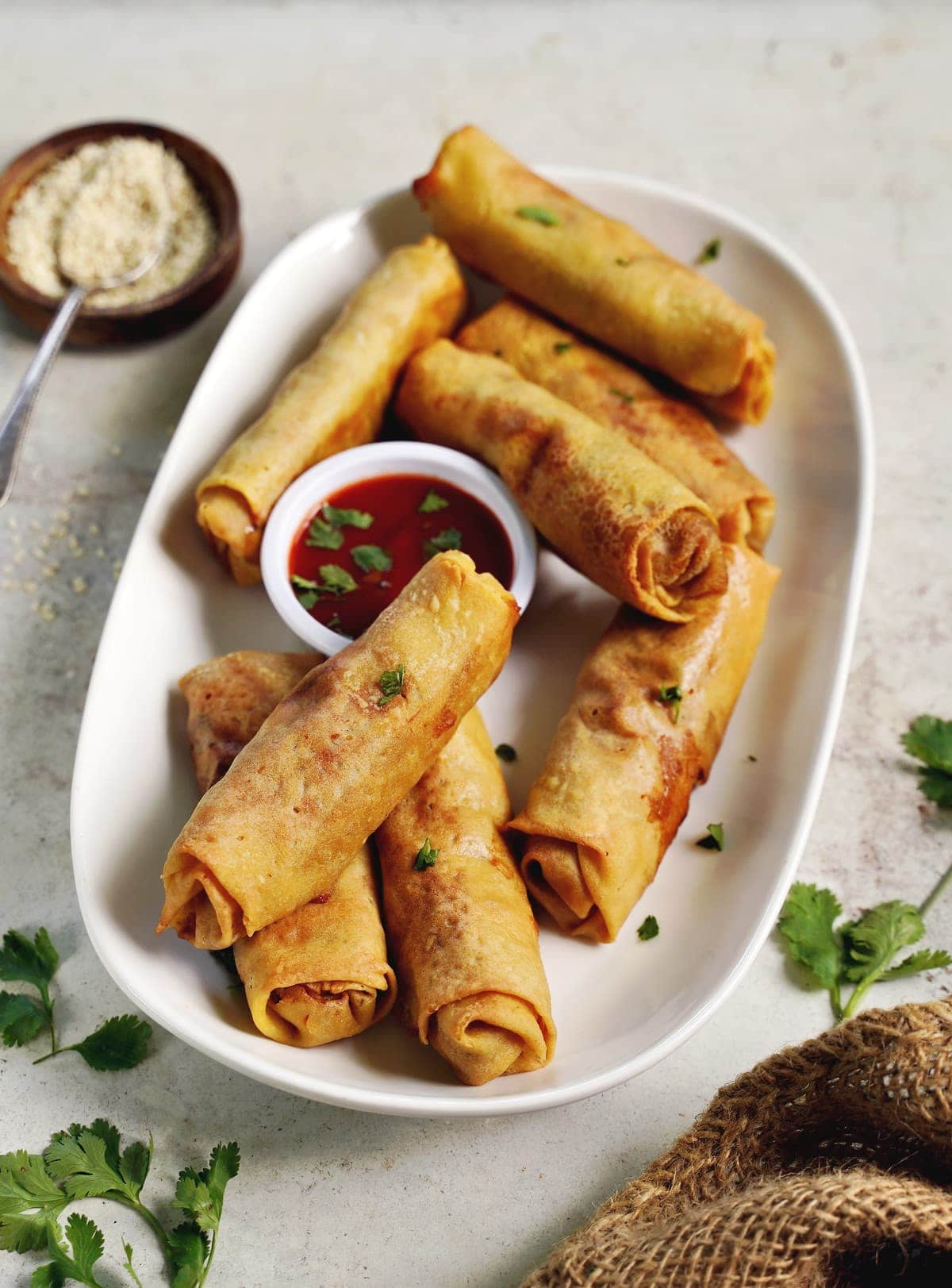 homemade crispy vegan spring rolls with gluten-free wrappers on white plate